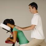 massage therapist giving chair massage